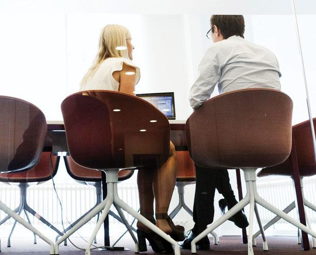 Male and female sitting at the office and talking