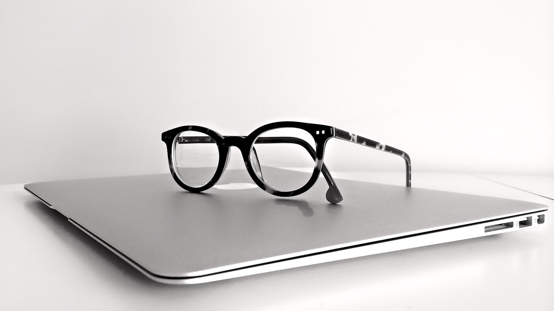 MacBook and glasses